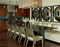 view in gallery modern dining room with a long table and a large rectangular chandelier