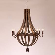 inspired by antique wine wooden barrel this chandelier is constructed by reclaimed wood staves and is strapped with a dark rust metal ring and curving