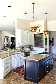 kitchen makeover white cabinets black island brass hardware world market lotus pendant light vintage rug makeovers