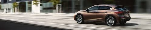 2018 infiniti hatchback.  2018 q30 hatchback driving on city road and 2018 infiniti hatchback
