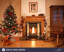 Living Room Christmas Decoration Living Room With Open Fire Christmas Decorations And Tree