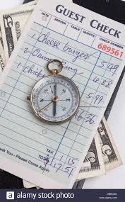restaurant expense guest check and compass concept of restaurant expense stock photo