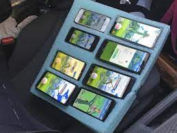 Pokemon Go superfan caught playing game on eight phones at once on highway  | The Independent
