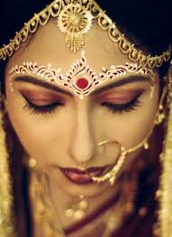 this forehead design is ideal for a bengali bride the red bindi looks superb with the red white design