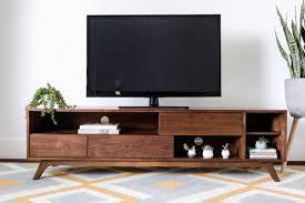 a dark mid century modern wood tv stand