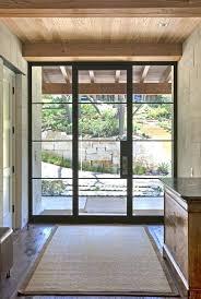 glass and steel front door for blending outdoors indoors entry shades doors