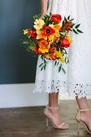sun kissed bright wedding flowers utah calie rose daffodil poppy bouquet  www.calierose.com