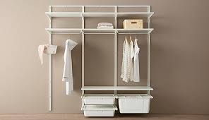 this algot bination es with wall uprights shelves storage bo and clothes rails