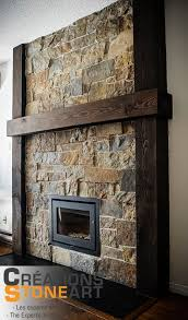 fireplace done with kiamichi natural thin stone veneer from robinson rock black porcelain tile for