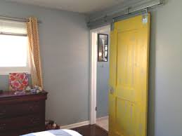 Spectacular Yellow Painted Single Sliding Barn Doors For Homes With Brown  Dresser As Well As Grey Wall Master Bedroom Painted Ideas