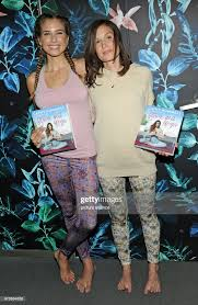Model Cathy Hummels and yoga teacher Flora Fink present the book ...