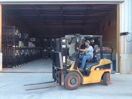 4 12 14 spring has arrived noland farms inc noland farms inc blake demonstrating his forklift skills as he loads boxes into the tender