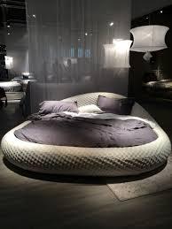 Unpractical grey round bed ...