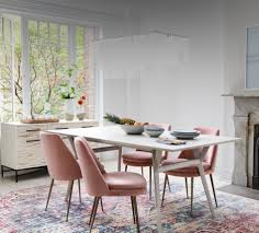 lighten up with our best selling mid century dining table now available in pebble gray