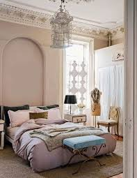 fabulous birdcage chandelier beige staine wall white framed bed
