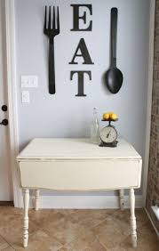 eat letters and oversized black utensils to decorate a wall
