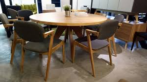em wood round dining table