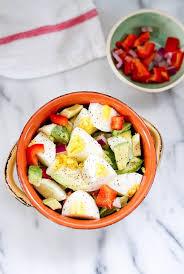 egg and avocado salad eating bird food