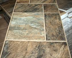 laminate flooring that looks like tile or stone designs