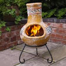 interesting chiminea for outdoor fireplace ideas yellow clay chiminea with black iron stand for outdoor furniture ideas