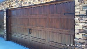 walnut garage doorsWalnut wood grain finish Clopay Gallery garage door with handles