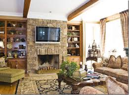 brick fireplace mantels with tv above and bookshelves for living room