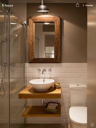 brown floor tile bathroom. half white tiles with contrast brown wall and bathroom fixtures accents floor tile w