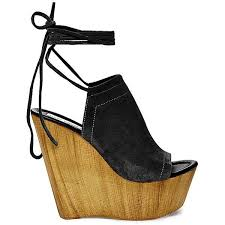 bonelli the mule has never felt so relevant sitting on a chunky wooden wedge with a luscious suede upper bonelli begs to be teamed with wide leg