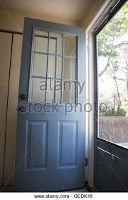 house front door open. Open Front Door To A House - Stock Image T
