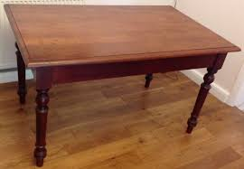 vintage dining table in solid dark wood