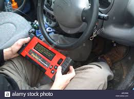auto electrician stock photos auto electrician stock images alamy auto electrician holding a computerised engine management diagnostic readout digital display in drivers seat of