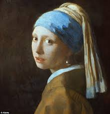 original work girl with a pearl earring which was painted by vermeer in 1665 has