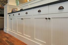 cabinet knobs and pulls. white cabinets with bronze knobs and cup pulls. i think would do a nickel cabinet pulls