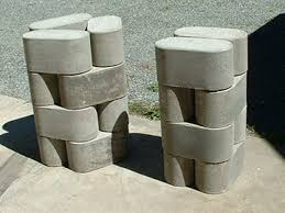 Re-usable molds build concrete blocks from waste concrete to conform to any  area. Reduce environmental impact AND save money.
