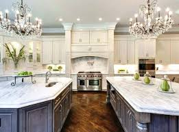 beautiful kitchen with white cabinets two islands chandelierarble carrara countertop countertops pros cons ch