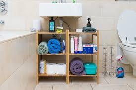 the ikea ragrund shelves set up under a bathroom sink