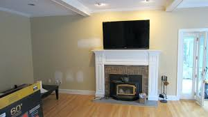 can i hang a tv above wood burning fireplace over too high hanging how