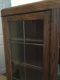 vintage oak bookcase with leaded light glass doors