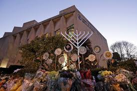 a menorah is tested outside the tree of life synagogue in preparation for a celebration service at sundown on the first night of hanukkah sunday dec
