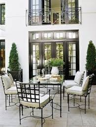 gorgeously elegant outdoor dining area love all the wrought iron lush