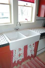 vintage kitchen sinks like this 2 leg fireclay console were