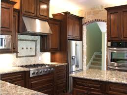 brown cherry wood kitchen cabinet and kitchen island with