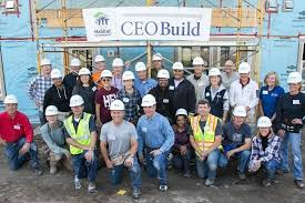 Leaders Don Tool Belts for Habitat for Humanity's CEO Build