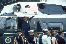 nixon office. president richard nixon with arms outstretched veed fingers at doorway to helicopter as he departs after his resignation others on ground office