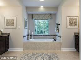 Butterfly Beige Granite traditional master bathroom with dropin bathtub & high ceiling 1015 by guidejewelry.us