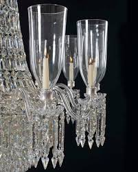 a fine victorian cut glass chandeliers of classic tent and waterfall design the frames supporting