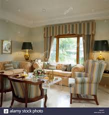 Peach Living Room Peach Sofas And Striped Wingchair With Matching Curtains In Small