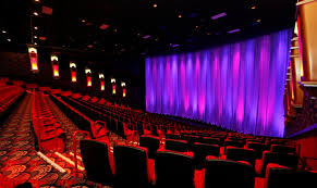 Warren Sells Operating Theaters To Regal Entertainment Group