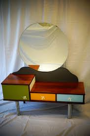 dressing table in multicolored wood and metal with round mirror 1960s previous next