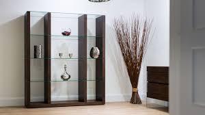 dark wood and glass shelving unit